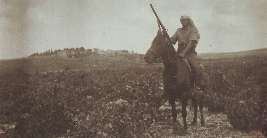 Guard with the town in the backdrop, 1920's