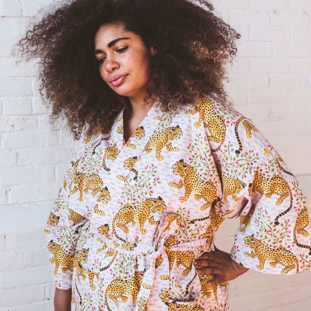 woman wearing Bagheera screenprinted robe with leopard print