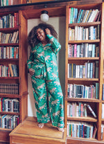 Load image into Gallery viewer, woman wearing Bagheera long sleeve pajamas, bookcase