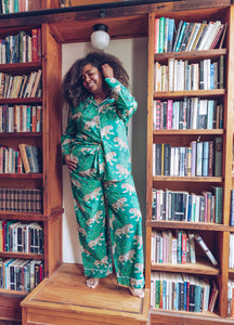 woman wearing Bagheera long sleeve pajamas, bookcase