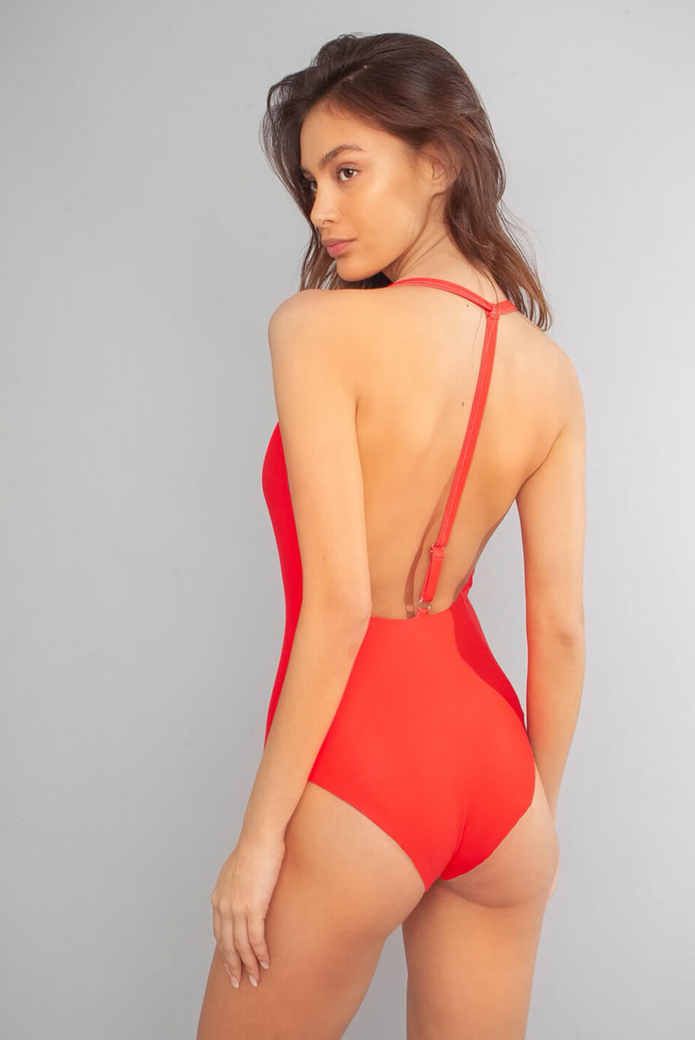 Wolven Santorini Deep–V One Piece Deep v–neckline Adjustable back strap Mid–coverage bottom Reverses to solid red Sustainable Swimwear