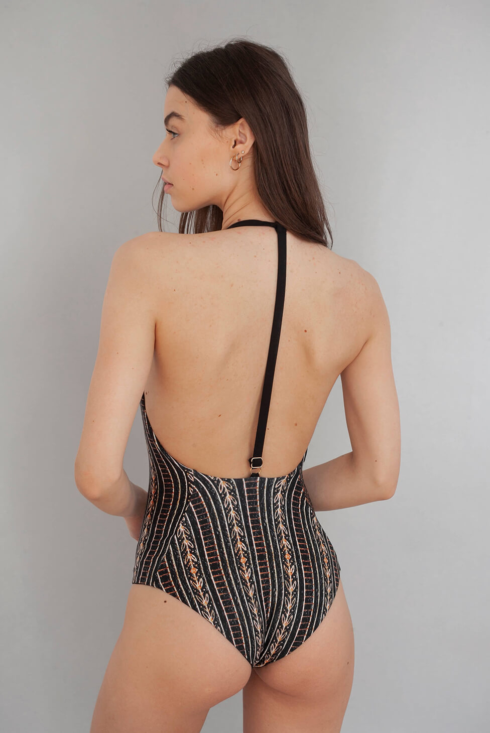 Wolven Zephyr V-One Piece Deep V neckline Adjustable back strap Mid–coverage bottom Reverses to solid black Reversible Sustainable Swimwear