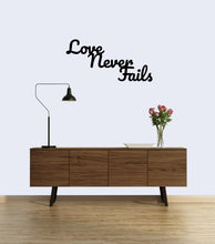 "Load image into Gallery viewer, ""Love Never Fails"" Sign"