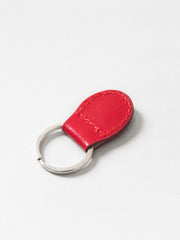 Paperthinks Recycled Leather Coin Pouch in Scarlet Red-Detail Image of keyfob