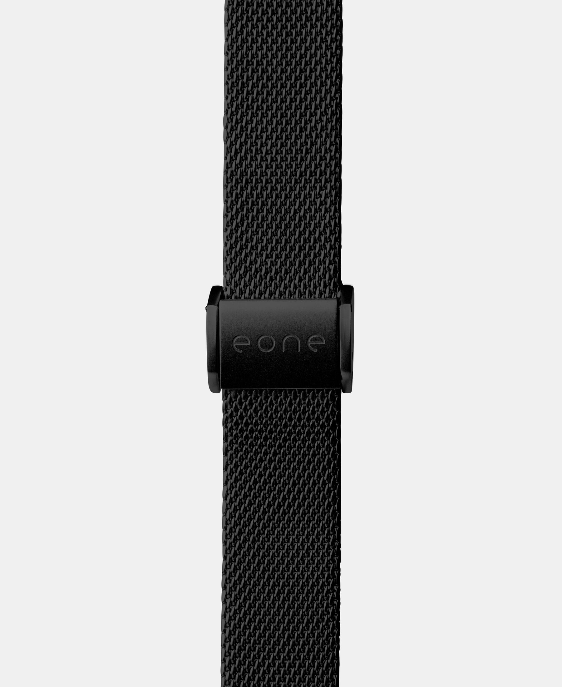 Load image into Gallery viewer, A photo shows the strap lying on a flat surface. One part has a fixed clasp and the other part has an adjustable clasp for a custom fit.
