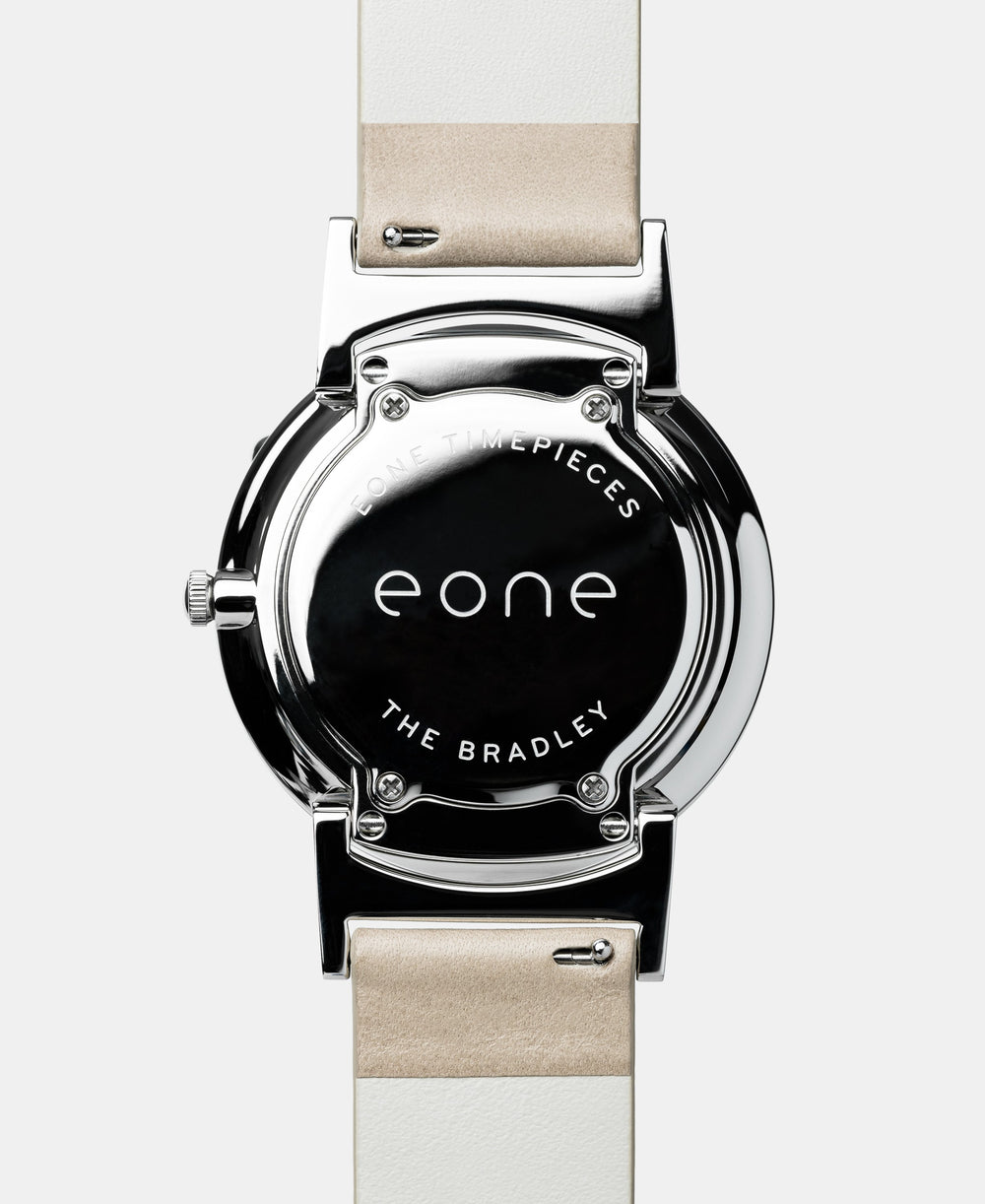 A photo of the back of the watch, showing the back plate engraved with the Eone logo.