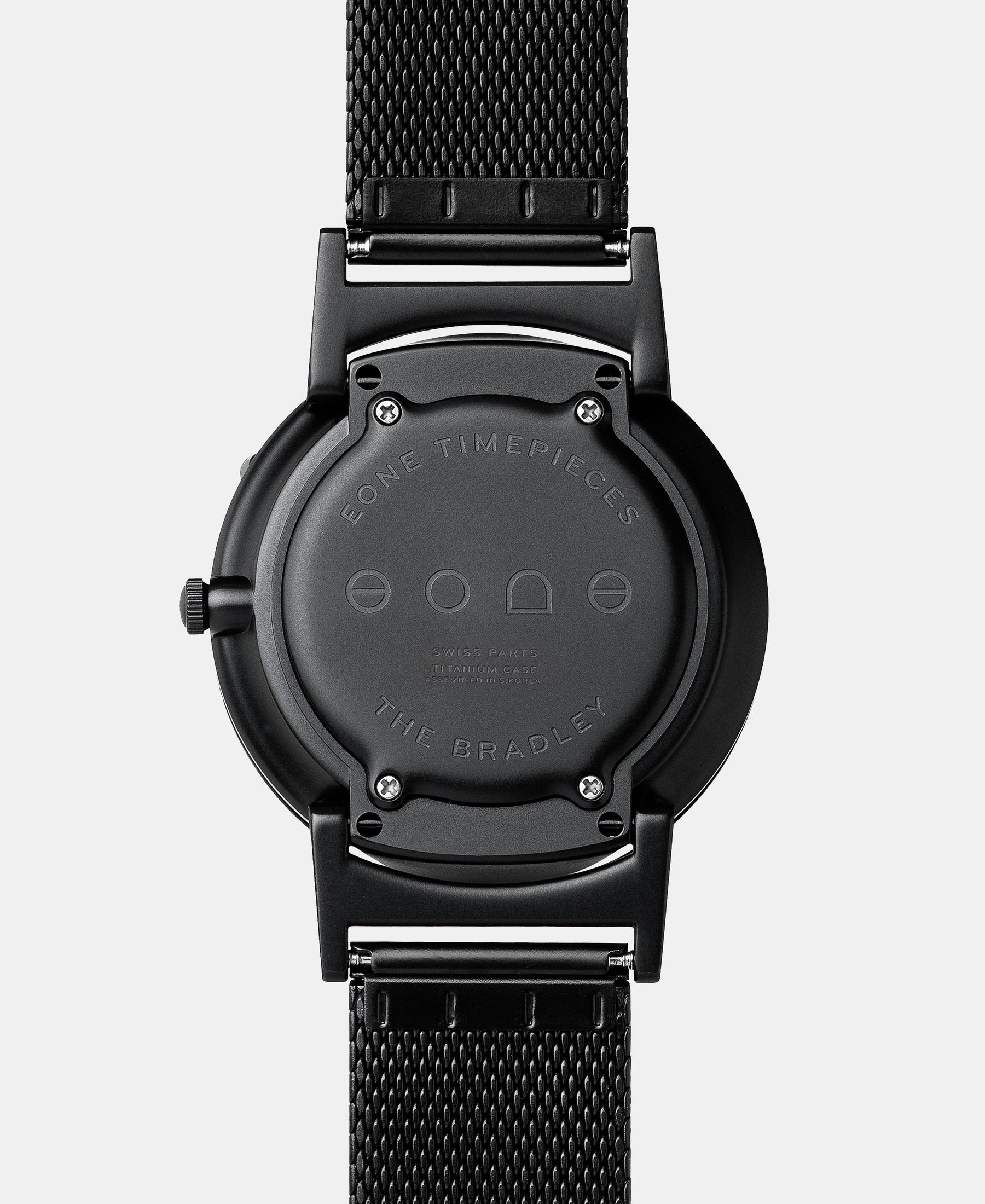Load image into Gallery viewer, A photo of the back of the watch, showing the back plate engraved with the Eone logo.