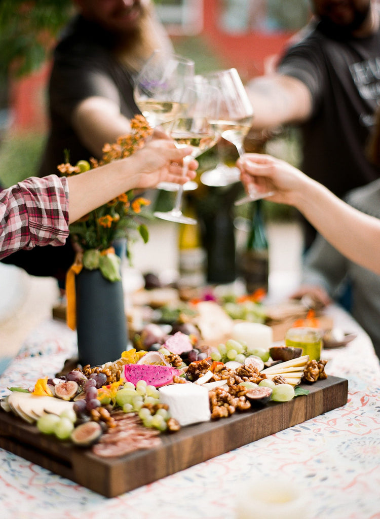 group gathering with wine and cheese