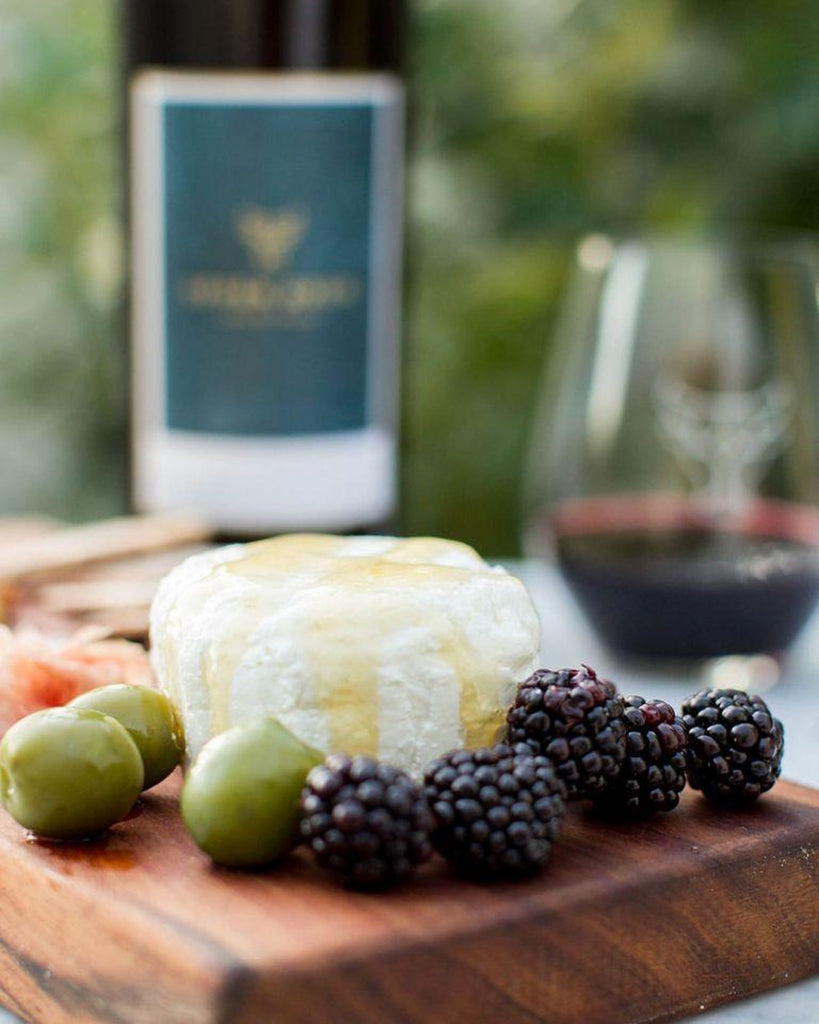 Chevre cheeseboard with wine