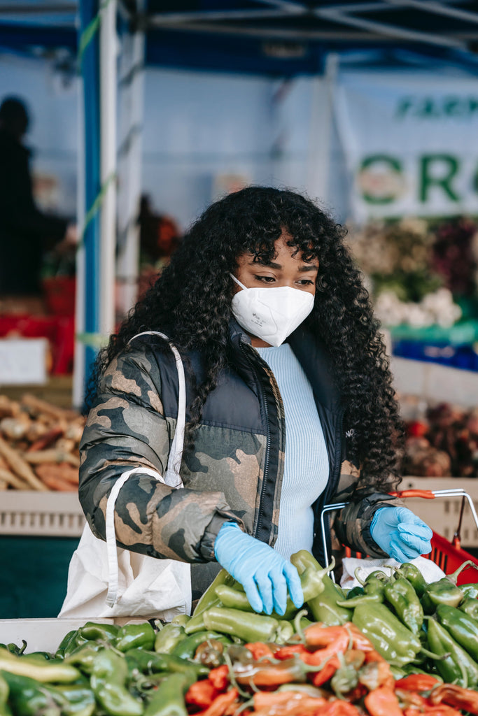Woman shopping for peppers at market