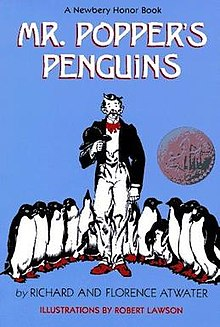 The background of the book cover is a light blue colour. There's a man in the middle of the cover. He is wearing a black suit jacket, white shirt and trousers and a red bow tie and shoes. Surround him to each side are lots of penguins