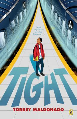 A boy is standing on a platform in amongst two trains. He's wearing a red jacket and black trousers and is looking at one of the trains