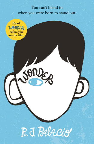 The cover has a sky blue background and an illustration of a boy on the front. Aside from his black hair, the only features of his face that has been drawn is his left eye