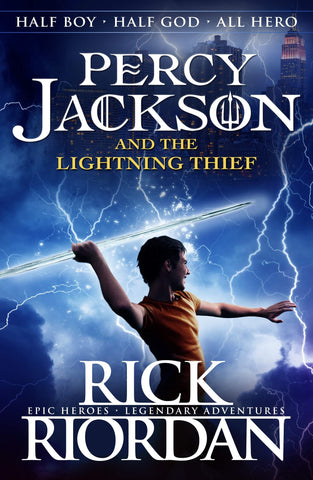 The book cover of Percy Jackson and the Lightning Thief by Rick Riordan. The book cover is blue and has lightning strikes all over. There is a boy - Percy, on the cover. He is holding an object like he's about to throw it like a javelin