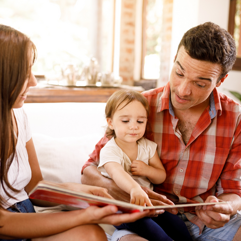 Parents reading with their child