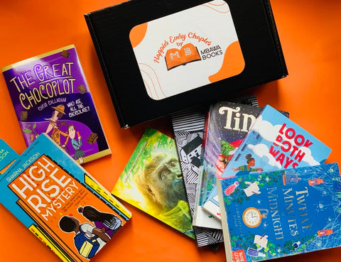A Happier Every Chapter subscription box on an orange background with lots of diverse books surrounding it