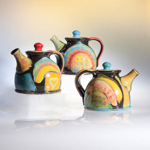 Large Pottery Teapot with Hand Decorated Design and Unique Shape