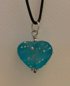 Etched heart pendant with fine silver