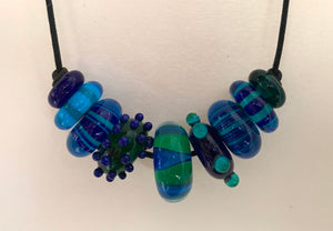 Glass beads on a cord
