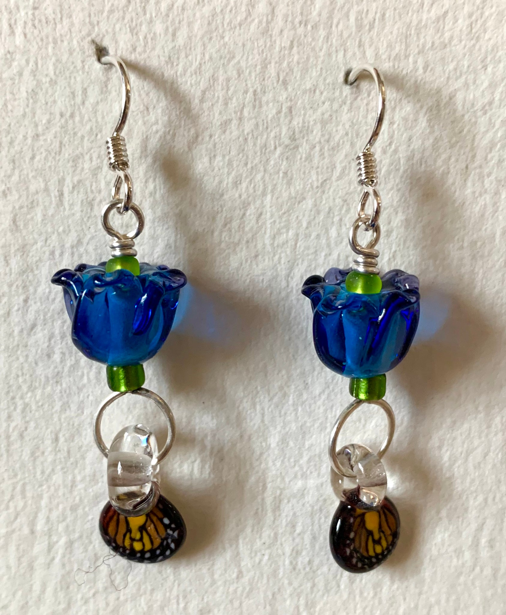 Flower earrings (blue with butterfly wings)