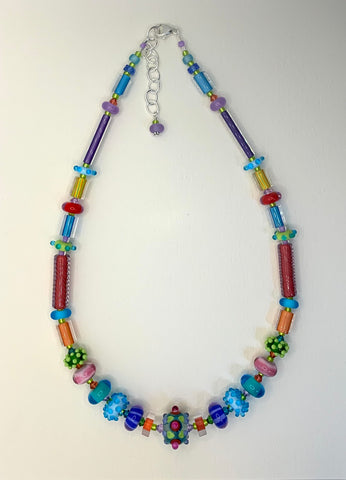 Pastel symmetrical necklace with some furnace beads