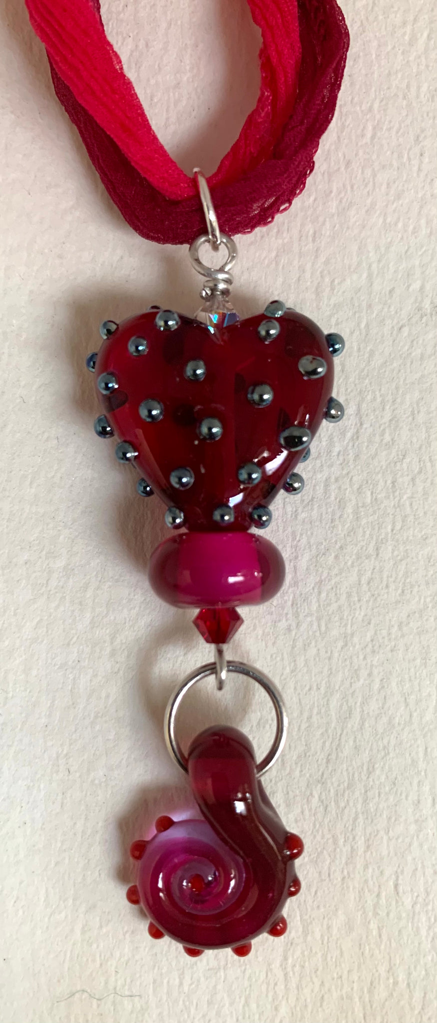 Red/pink/silver Heart pendant with spiral and silk ribbon