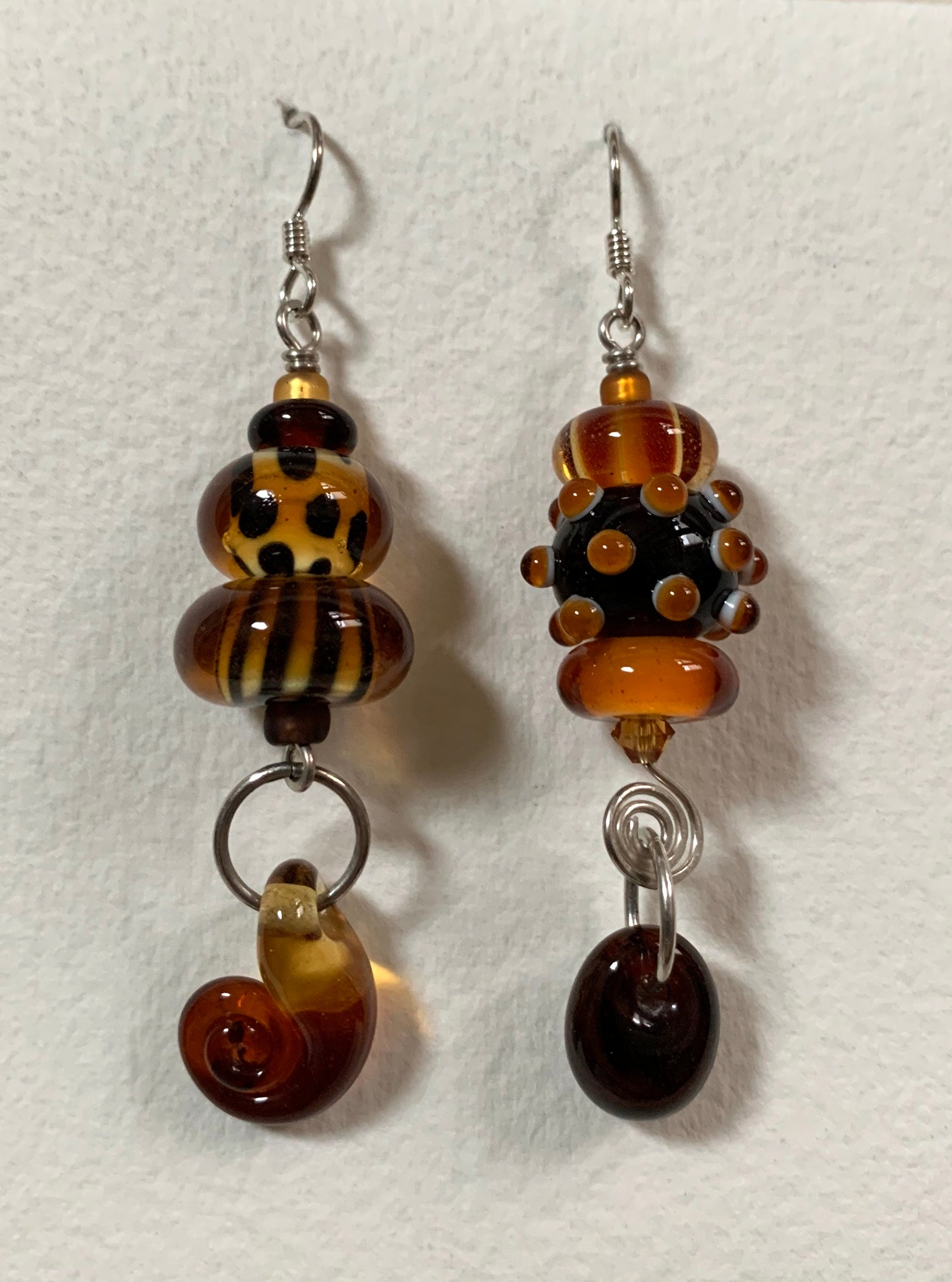 Large asymmetrical earrings (amber and brown)