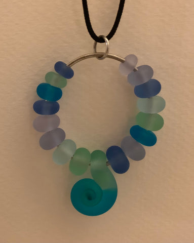 Pendant with etched glass beads and a Greek spiral