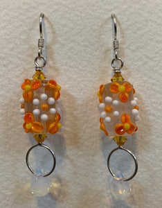 Flower earrings with opalescent crystals