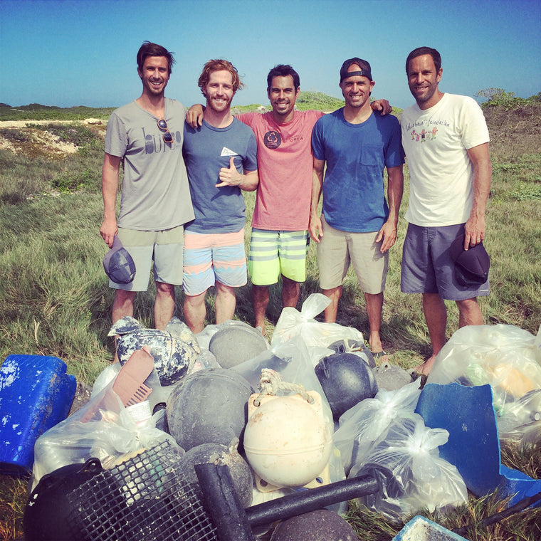 Bureo Team Founders, Kahi Pecarro and Jack Johnson cleaning up Kahuku Beach