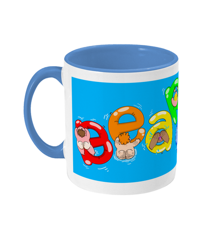 Gay bears paddling on inflatables spelling out Bear Soup on a blue and white mug