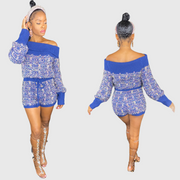 Navy blue sweater knit shorts set features a crop top with ribbed fold-over detail, bishop sleeves, metallic details