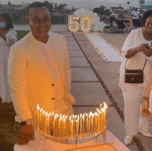 50th birthday gala party with Celebration Stadium and extra-tall gold candles