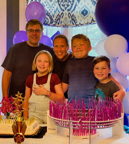 Aidan's family celebrating his 13th birthday July 24, 2021, two Celebration Stadium candle holders facing to make a circle of 200 candles