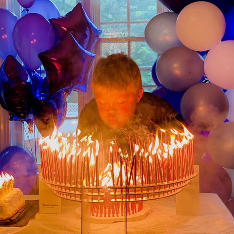 Aidan blowing out his 350 candles on two Celebration Stadiums