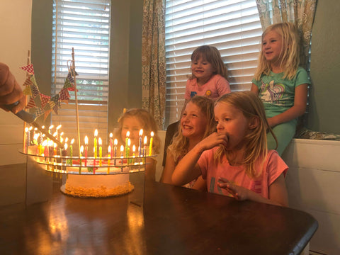 Kids love all the candles lit for granddad's 60th birthday celebration!