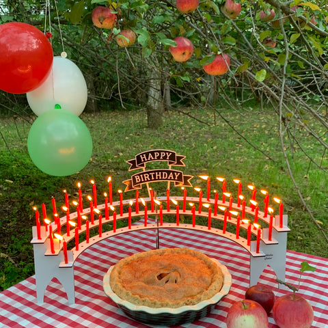 Outdoor birthday party in the apple orchard with white Celebration Stadium