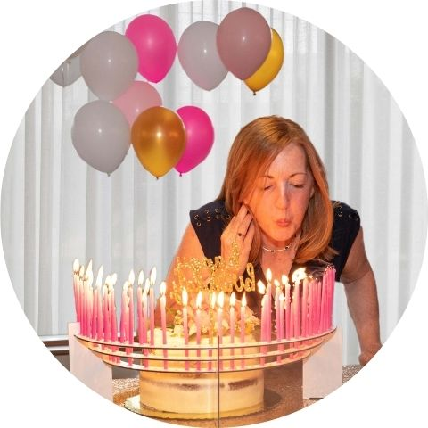 Your loved one will never forget their 50th birthday, blowing out a candle for every year on a Celebration Stadium. Pictured here white Celebration Stadium with extra-tall pink candles