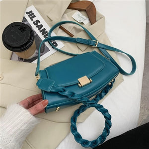 Twist Strap Shoulder Bag