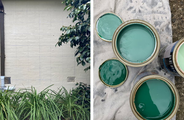 blank wall with green paint tins