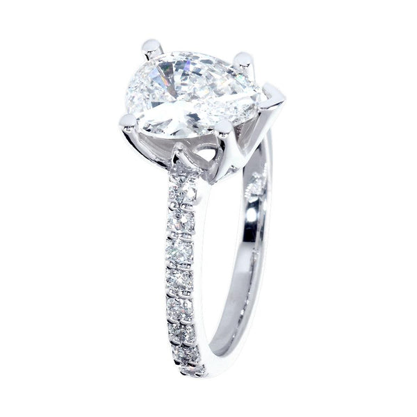 Engagement Ring Setting for a Pear Shape Diamond Center, 0.48CT Sides in 14k White Gold