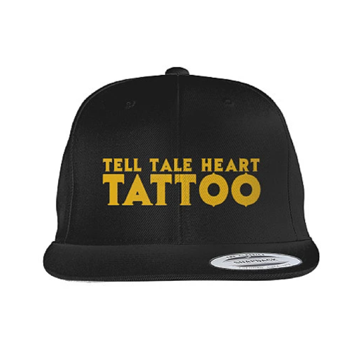 Tell Tale Heart Tattoo Logo embroidered in gold on a black flat bill hat.