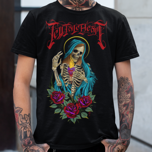 Virgin Mary skeleton tattoo style digital painting with red roses, green robe and sacred heart with Tell Tale Heart Logo above on a black unisex t-shirt worn by a tattooed male model. Close up image.