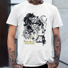 Load image into Gallery viewer, Two Headed Lady Monster on white t-shirt on a tattooed male model. Black and white with gold tears.