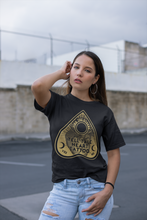 Load image into Gallery viewer, Tell Tale Heart Planchette Design on black t-shirt worn by female model