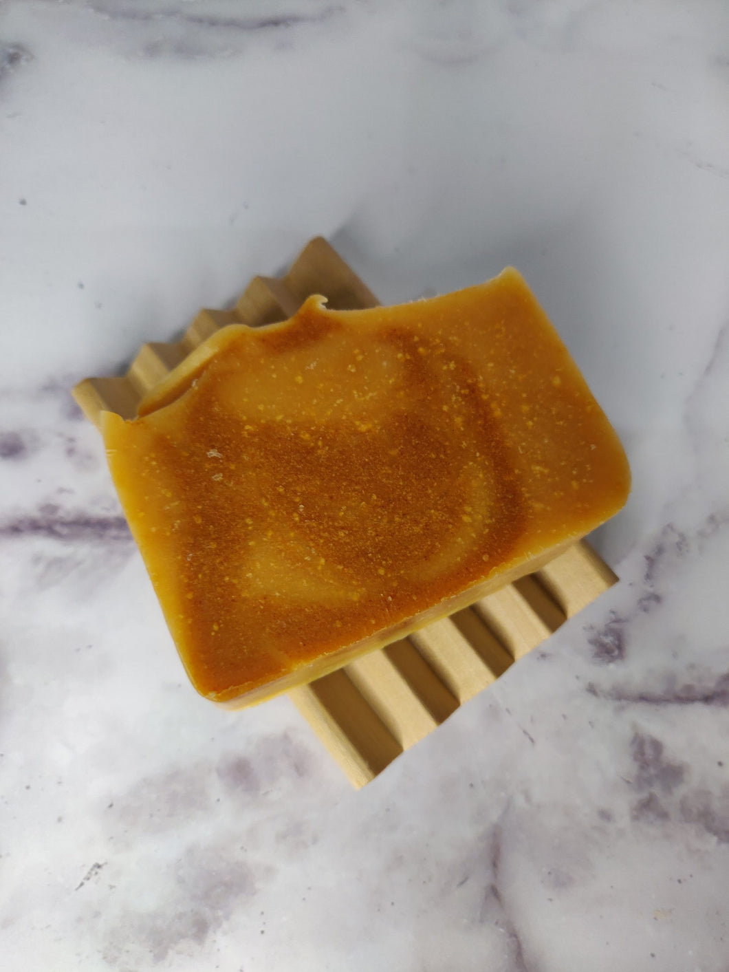 Get your skin glowing, with the Coconut, Turmeric and Honey soap. It's loaded with Coconut and Turmeric herbal powder, and other active skin-loving ingredients that are known to remove impurities, reduce inflammation, prevent acne, and balance the pH level of your skin.