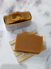Load image into Gallery viewer, It's loaded with Papaya and Turmeric herbal powder, and other active skin-loving ingredients that are known to remove impurities, reduce inflammation, prevent acne, and balance the pH level of your skin. It will help with hyper-pigmentation and naturally fade dark spots, over time.  This soap will keep your skin feeling soft, smooth and supple. This Papaya and Turmeric soap will gently soothe, heal and brighten lackluster, dull skin, thus giving a healthy, glowing complexion.