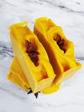 Load image into Gallery viewer, Tangerine Spice is a soothing, yet stimulating goat milk soap which stimulates the generation of new cells while uplifting your mood. It scented with a personal blend of Tangerine, Anise, Orange, and Clove essential oils. Goat Milk is loaded with vitamins, particularly vitamin A, which is the most important vitamin for the skin. It is both an anti-aging wonder and a lifesaver for dry and sensitive skin. All of these ingredients together make this bar of soap, a great skin-rejuvenator!