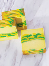 Load image into Gallery viewer, This soap bar has a scent of sliced lemons surrounded by hints of sweet sugar with just a hint of tart berries. It's loaded with coconut milk, cocoa butter and shea butter.