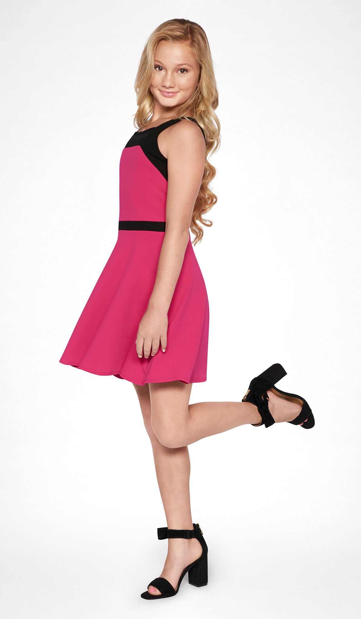 Sally Miller tween magenta fit and flare knit special occasion dress with black trim and mesh insert side view
